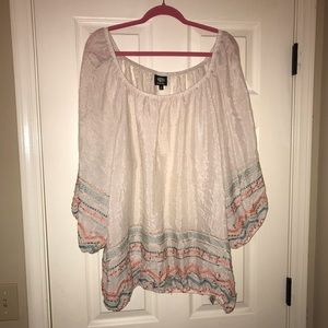 Flowy top with colored embroidery detail
